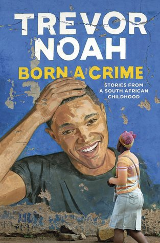 Blue Backgroud with a short haired illustrated man facing the camera. The man is painted on a wall with another person looking at him The author name Trevor Noah is prominently displayed with the title Born a Crime underneath it