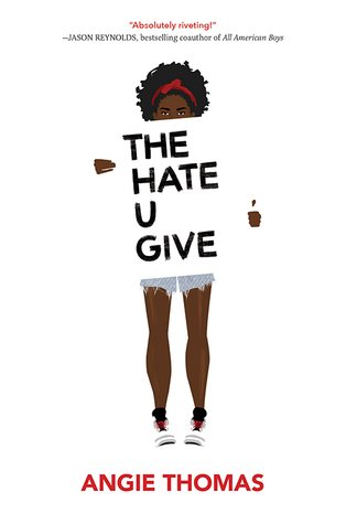 African American woman holding a sign with the title The Hate U Give