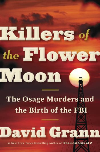 A deep red sunset with the outline of a watch tower. The Title  Killers of the Flower Moon The Osage Murders and the Birth of the FBI is displayed prominently covering the entire image